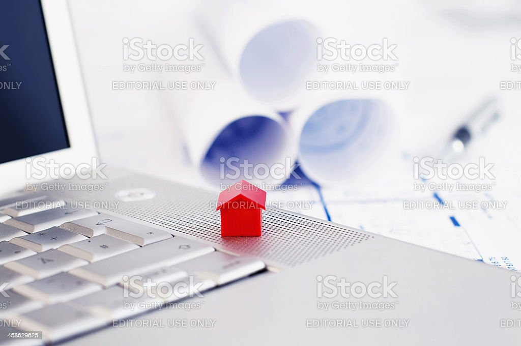 Red model house and laptop royalty-free stock photo