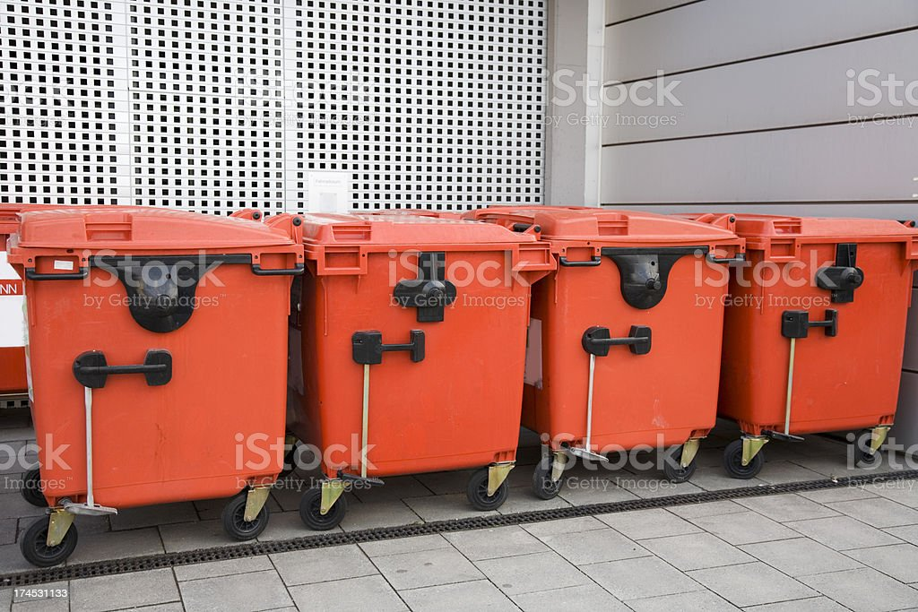 red modern trash containers in a row XL royalty-free stock photo