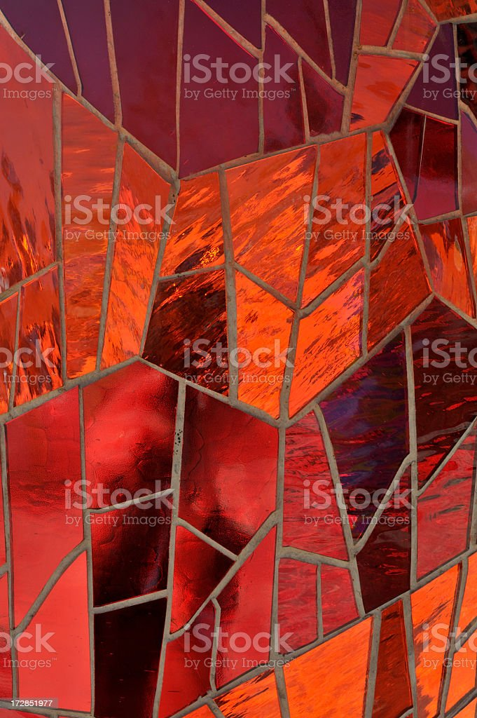 A red mosaic stained glass window royalty-free stock photo