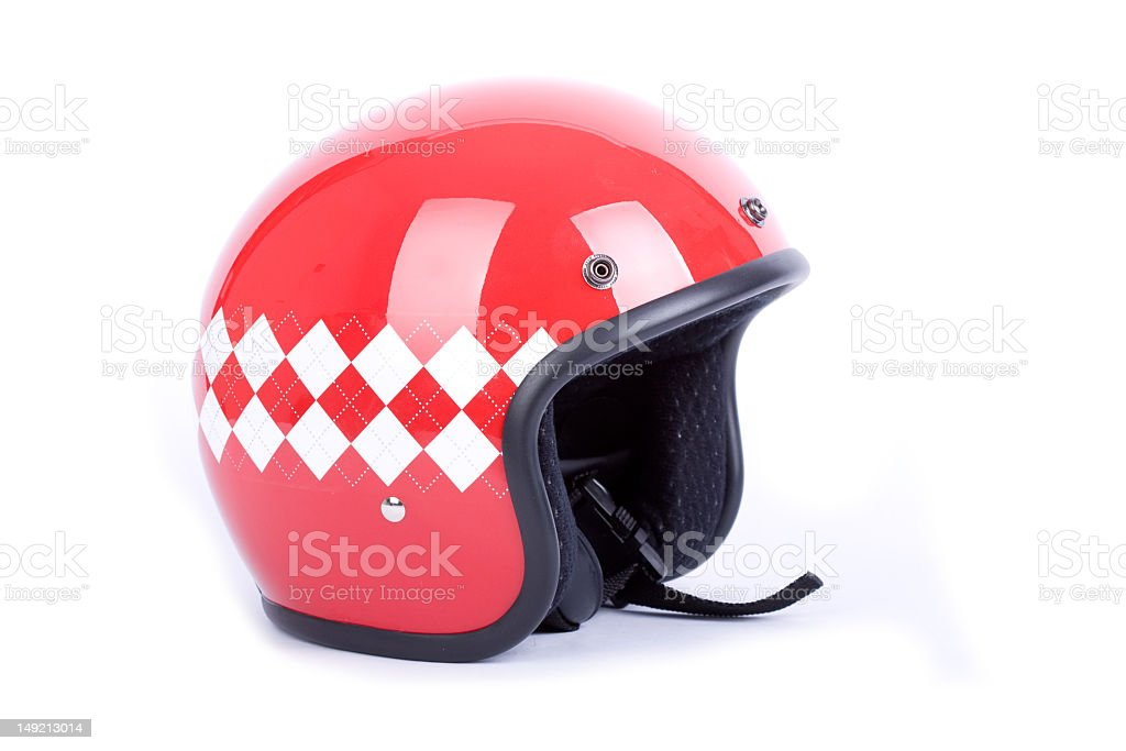 Red motorcycle helmet with a white and red diamond pattern stock photo
