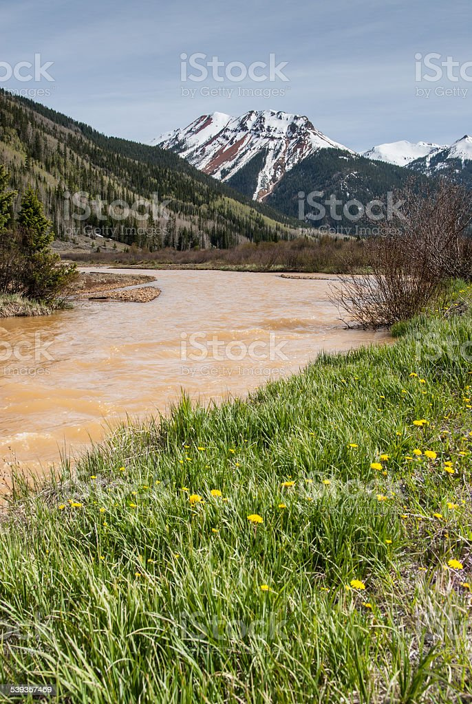 Red Mountain and Red Mountain Creek stock photo