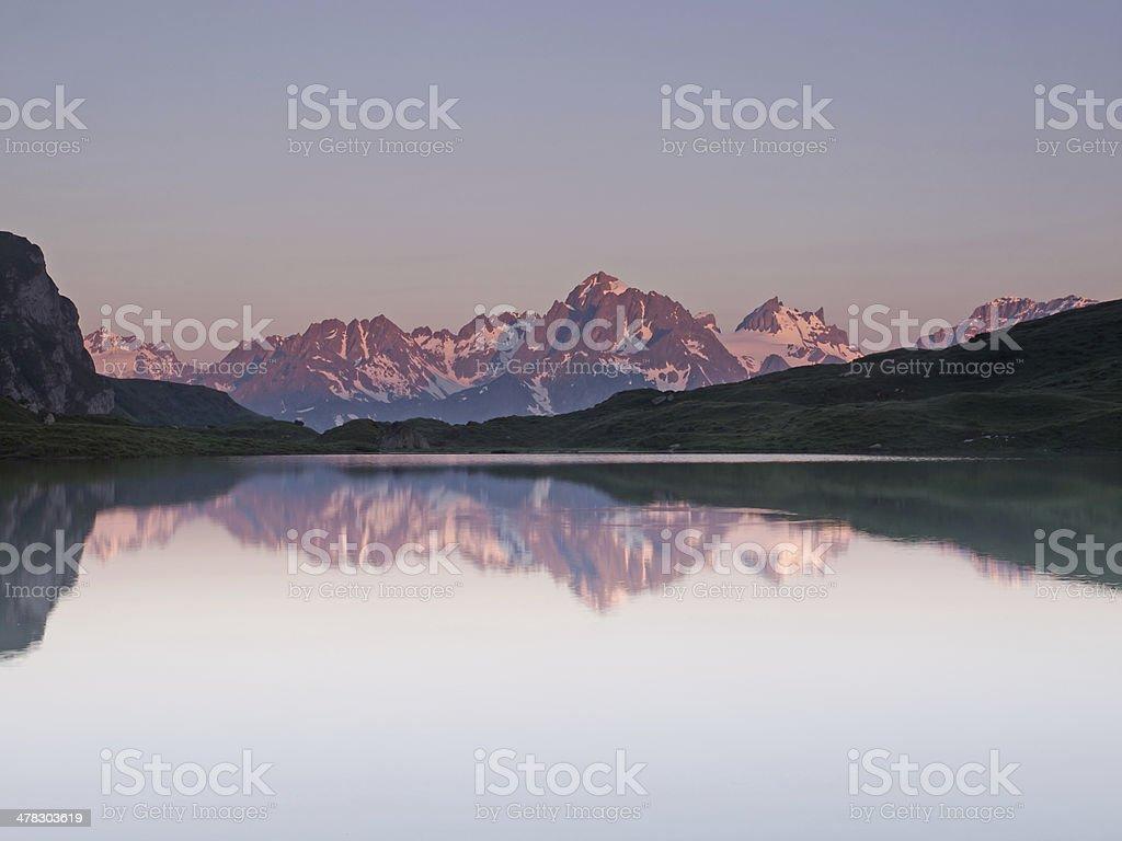 Red mountain range mirroring royalty-free stock photo