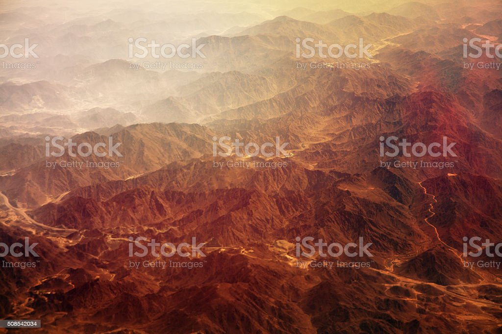 Red mountains in fog stock photo