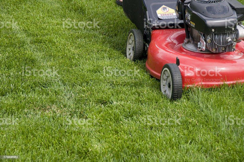 Red Mower Cutting Tall Grass stock photo