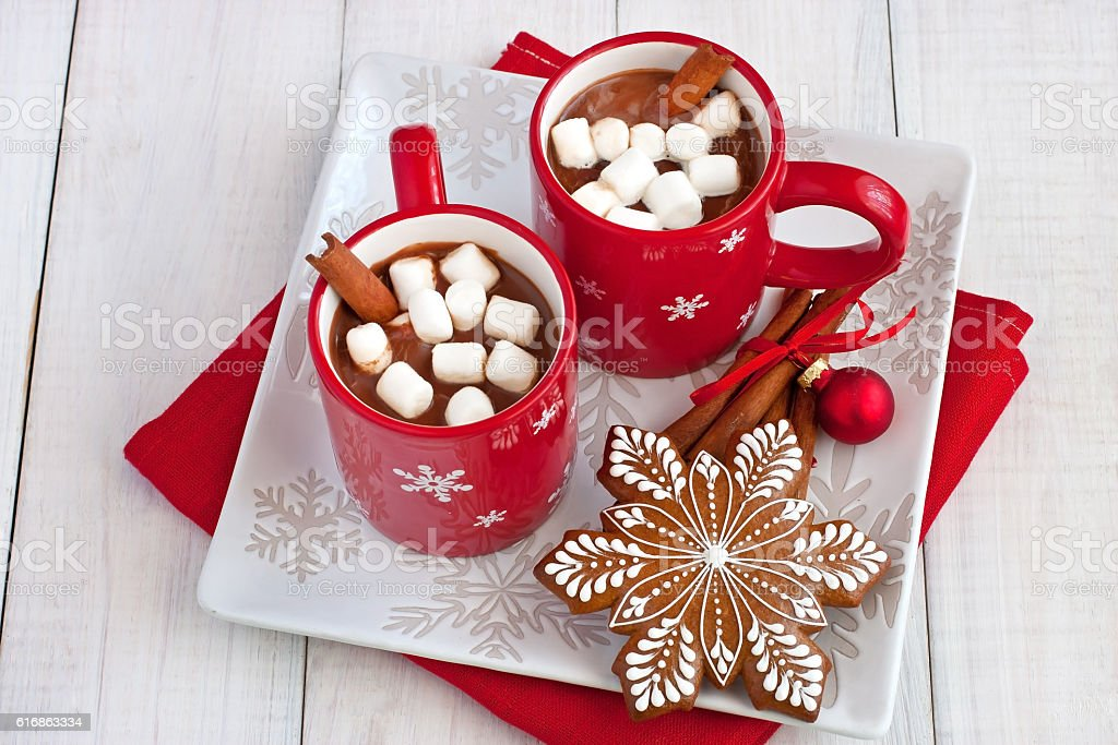 Red mug filled with hot chocolate and marshmallows stock photo