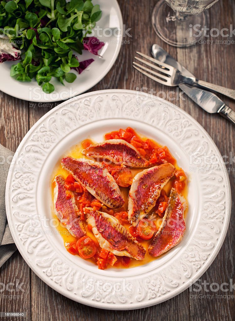Red mullet with fresh cherry tomatoes stock photo