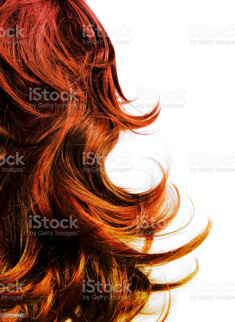 Red multi-toned hair against a white backdrop stock photo