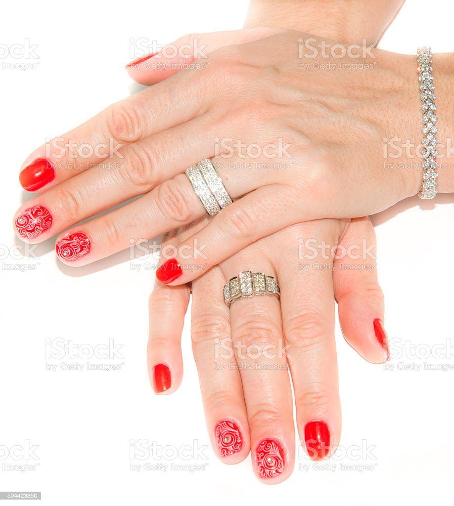 Red nail art design and diamonds stock photo
