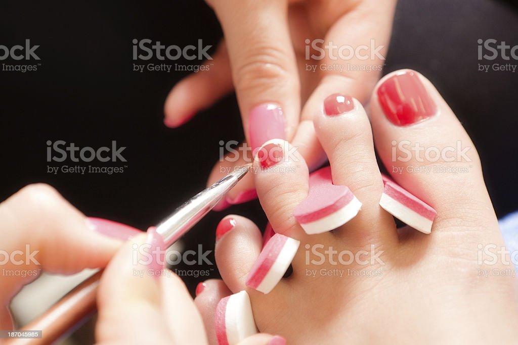 Red Nail Polish Application on Toenails in Spa Salon Horizontal royalty-free stock photo