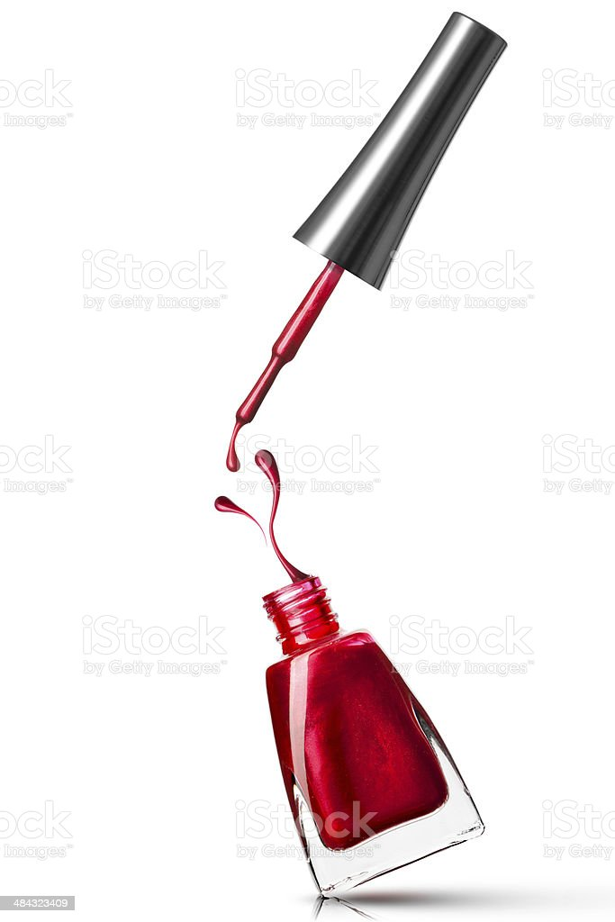 Red nail polish bottle with open cap stock photo