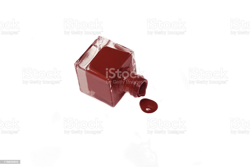red nail polish bottle with splatters isolated on white background royalty-free stock photo
