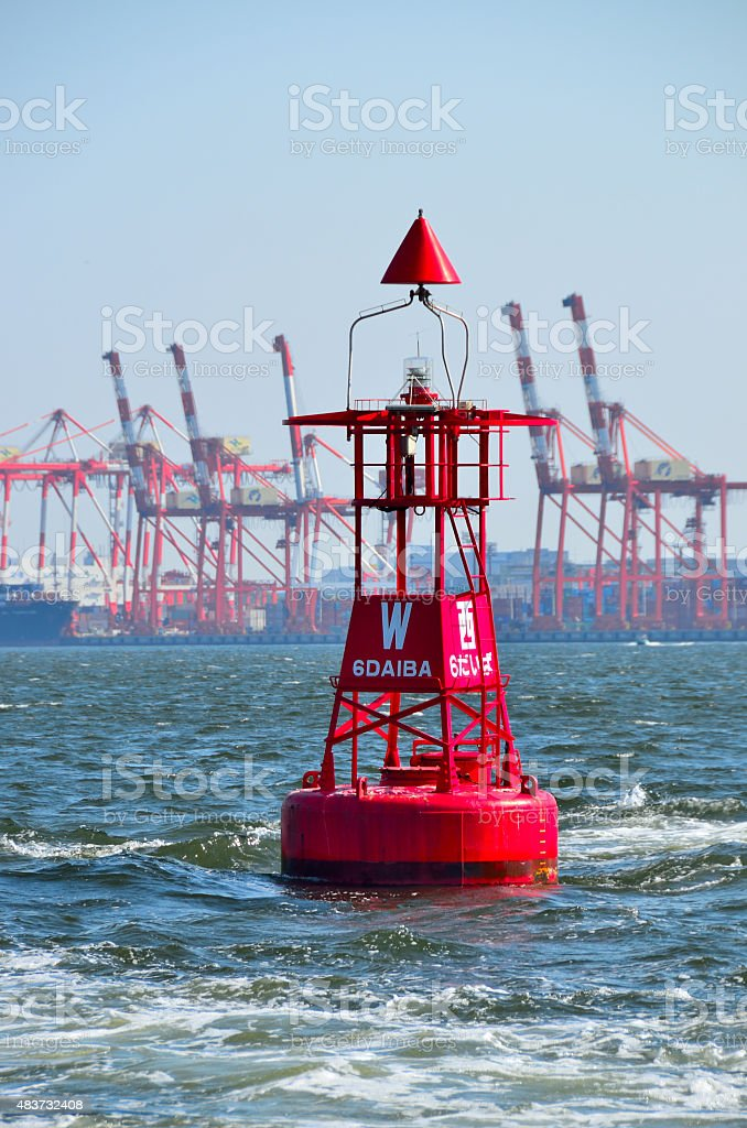 Red navigational buoy marker in sea channel,Tokyo Port, Japan stock photo