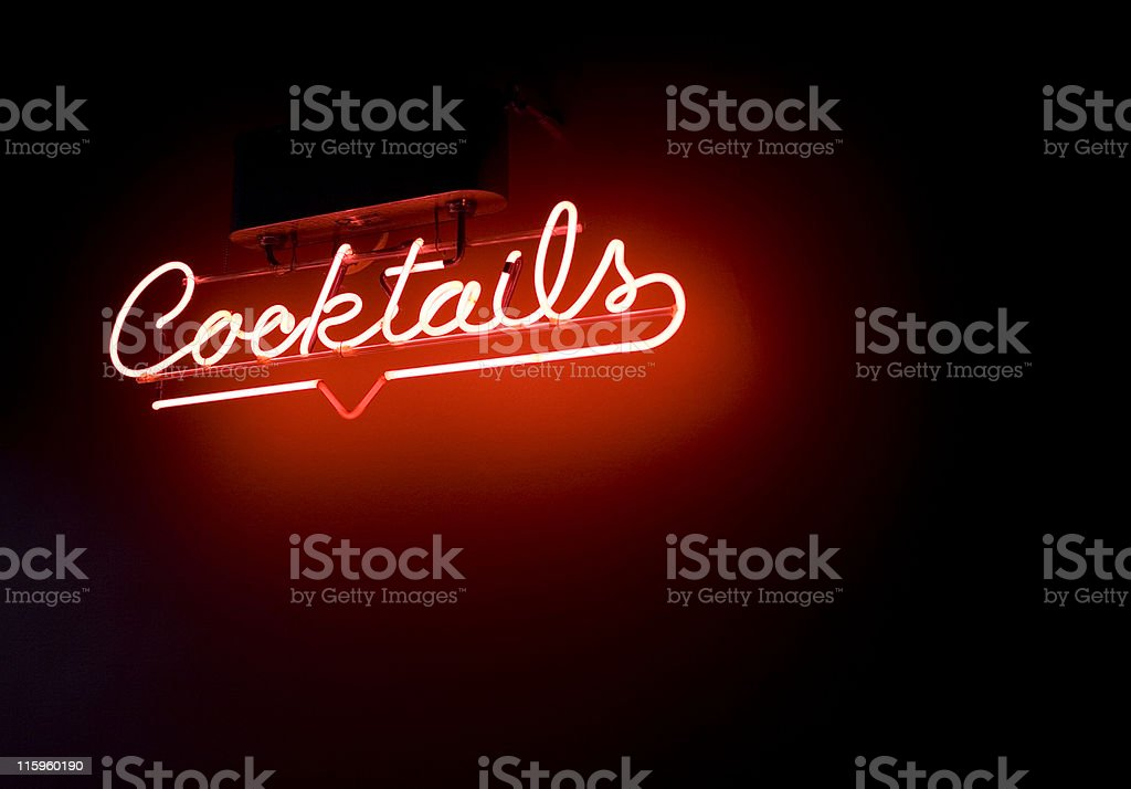 Red neon cocktails sign surrounded by darkness stock photo