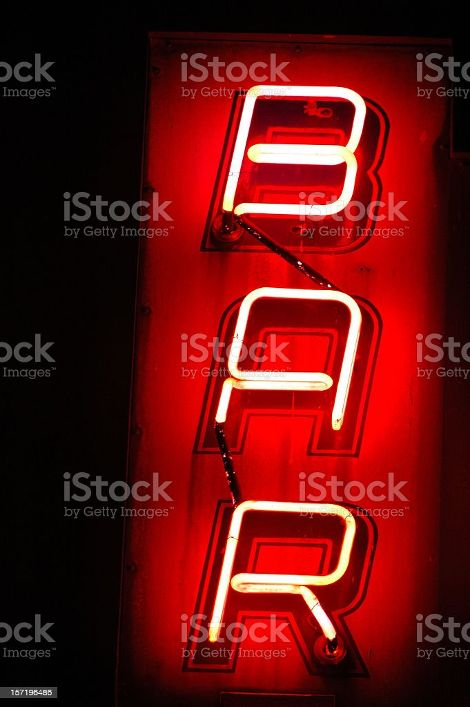 Red neon light vertical BAR sign royalty-free stock photo