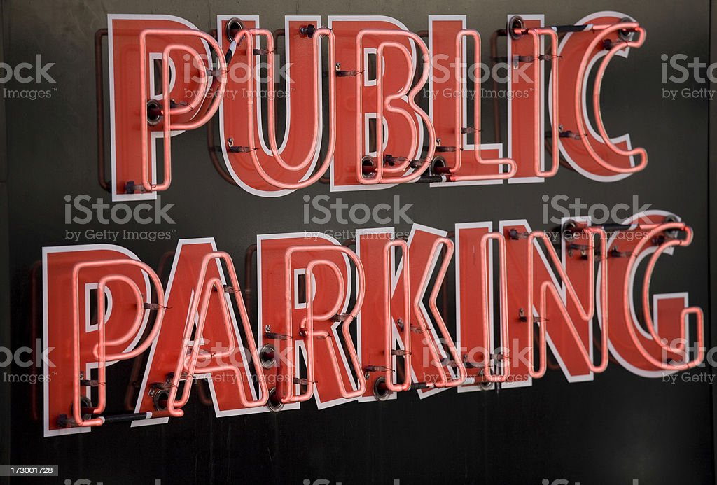 red neon public parking sign on royalty-free stock photo
