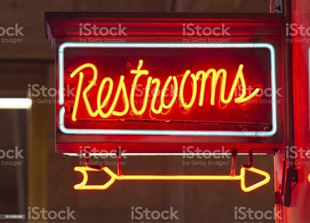 Red Neon Restrooms Sign Indoor Signage Arrow Pointing royalty-free stock photo