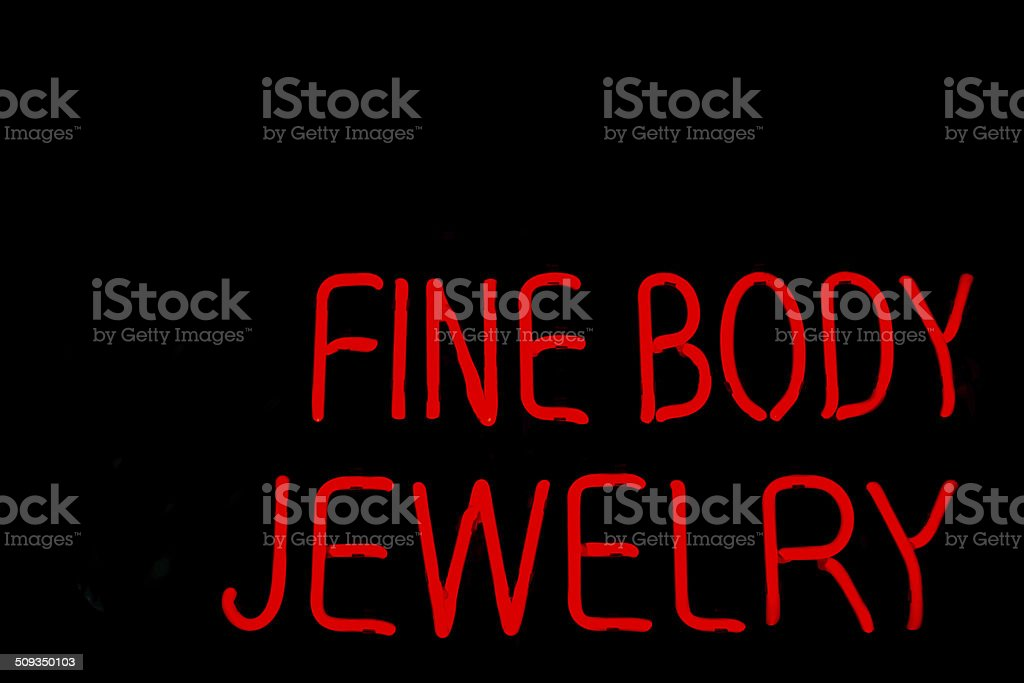 Red Neon Sign Advertising 'Fine Body Jewelry' stock photo