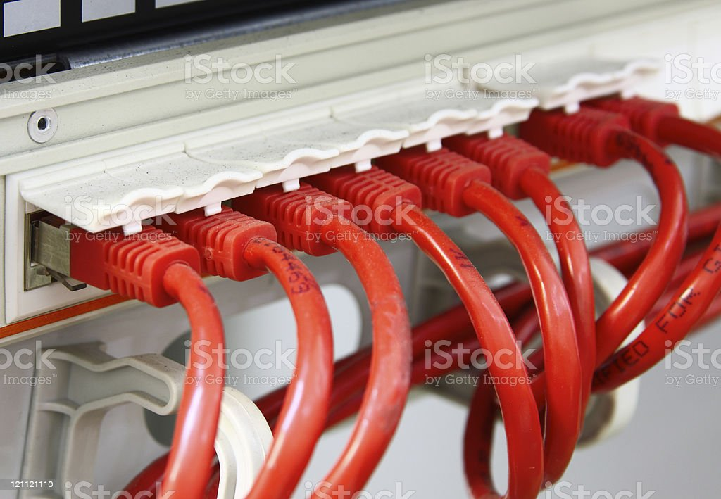 Red network UTP cables - Patch Panel stock photo