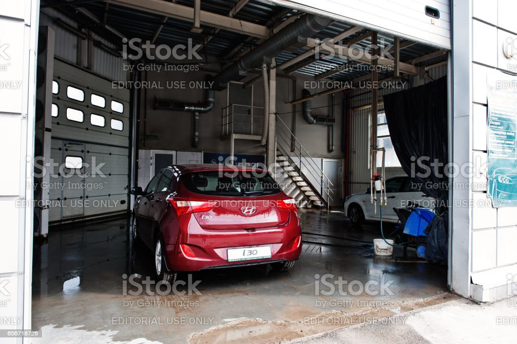 Kiev, Ukraine - March 22, 2017: Red new Hyundai i30 at car wash. stock photo