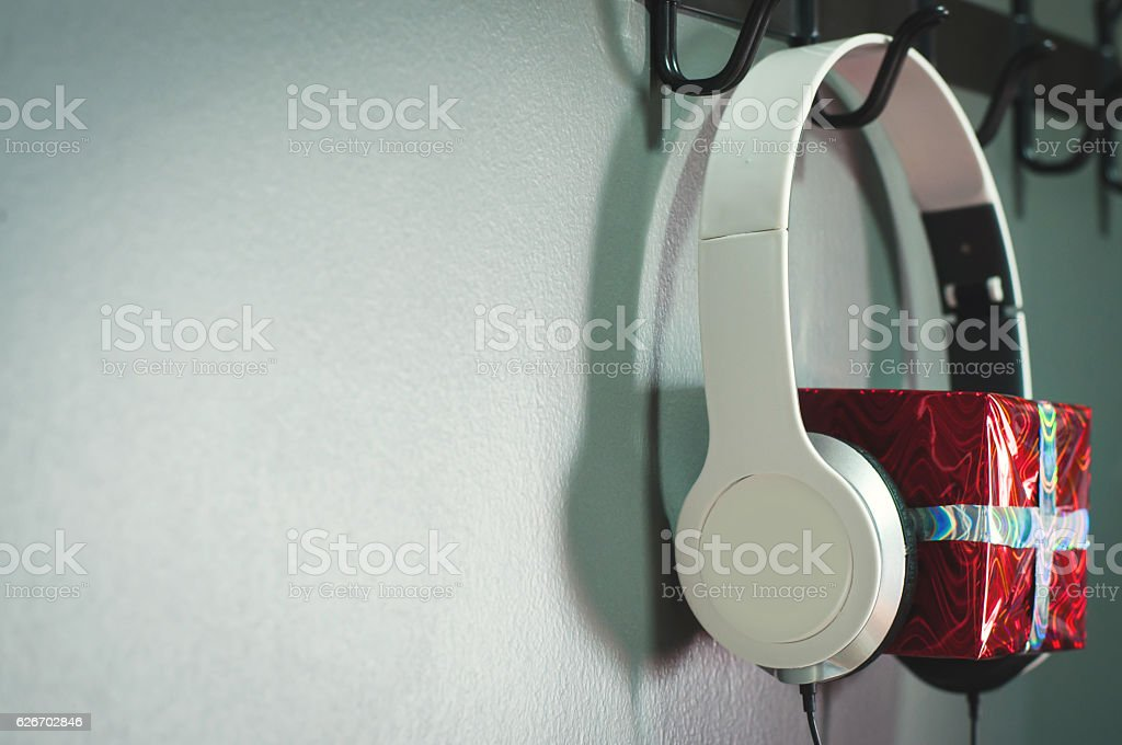 Red new year or christmas gift box with white headphone. stock photo