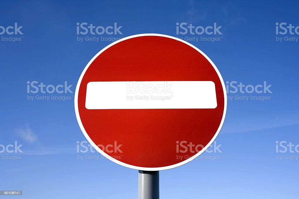 red no entry sign: do not enter against blue sky stock photo