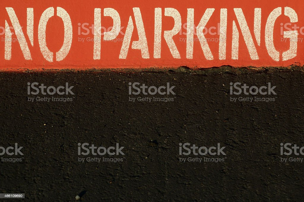 Red No Parking Curb and Street stock photo