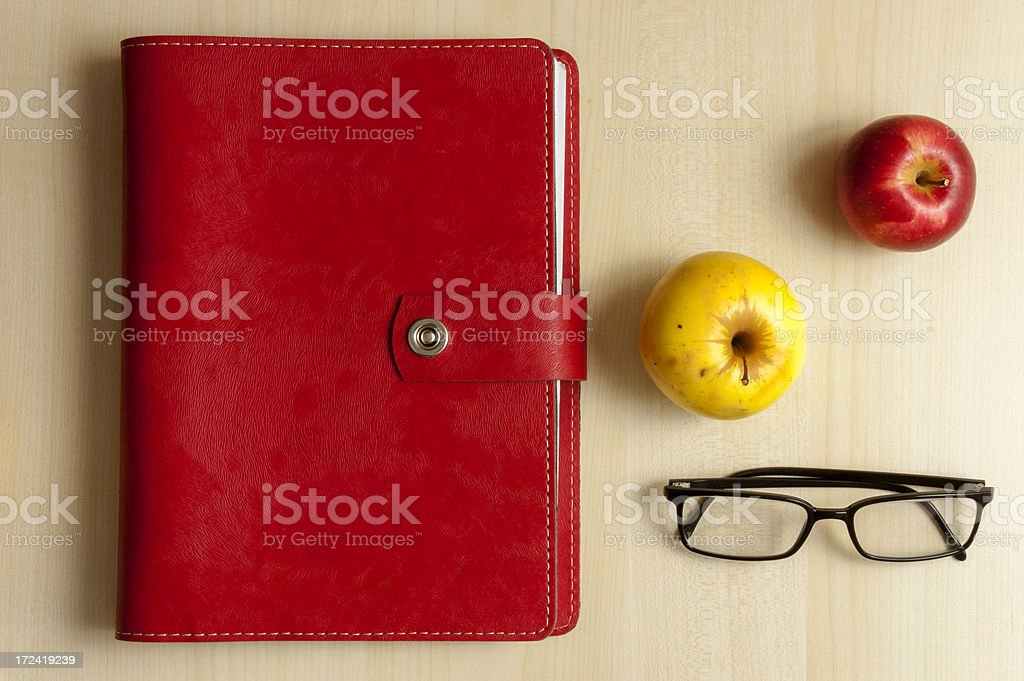 Red Notebook, Apples and Eyeglass stock photo