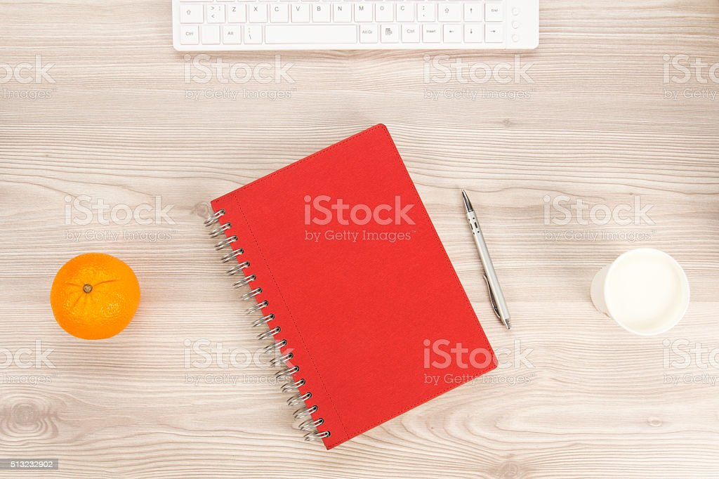 red notebook on the table stock photo