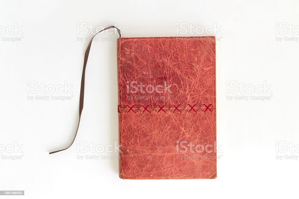 red notebook on white background stock photo