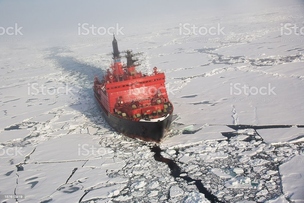 A red nuclear ice breaker ship in iceberg water stock photo