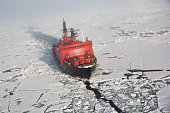 A red nuclear ice breaker ship in iceberg water