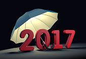 Red number 2017 under umbrella. New year mataphor