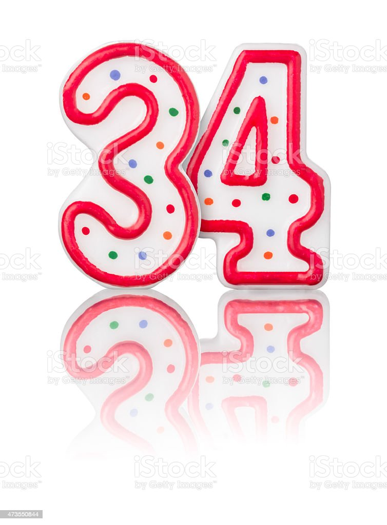Red number 34 with reflection on a white background stock photo