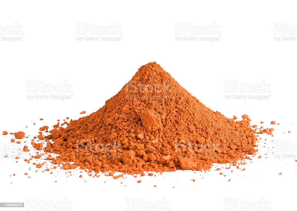 Red ochre pigment pile stock photo