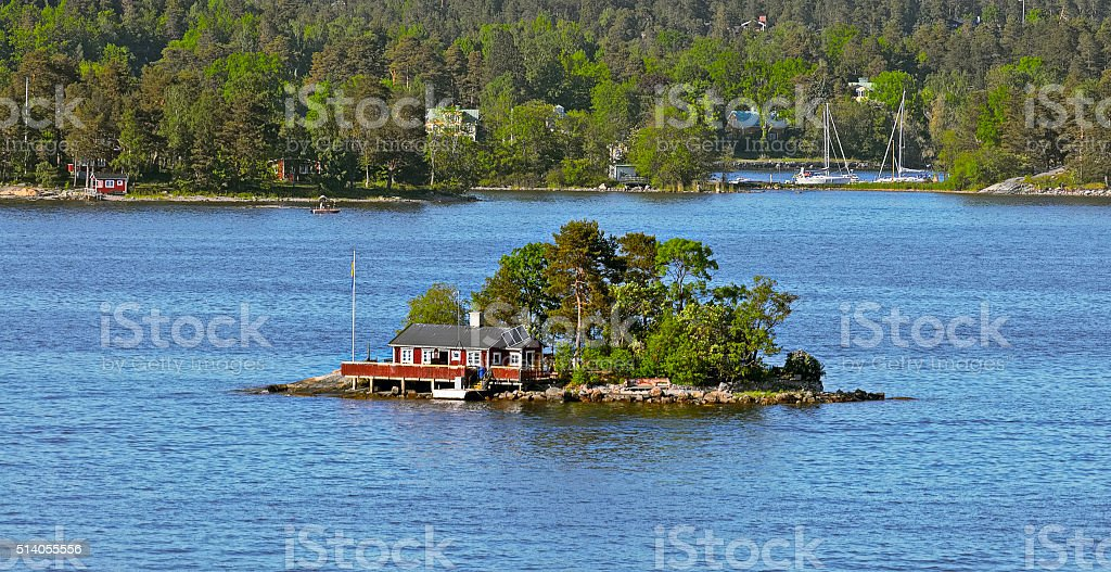 Red ochre wooden cabin on island stock photo