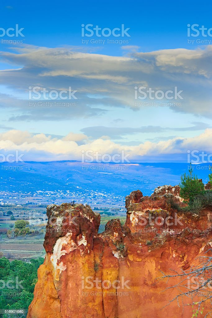 Red ocre rock near french village Roussillon in evening sun stock photo