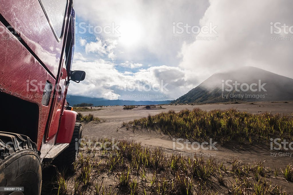 Red off road car at Bromo mountain, adventure trial stock photo