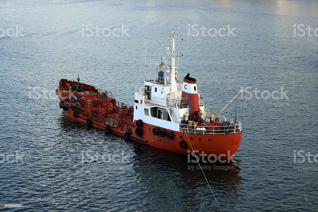 Red oil tanker boat stock photo