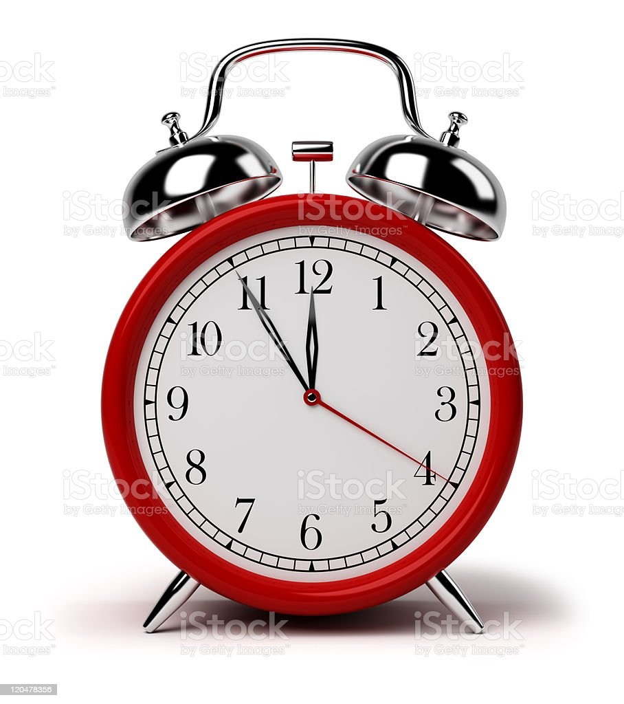 A red old school alarm clock on a white background stock photo
