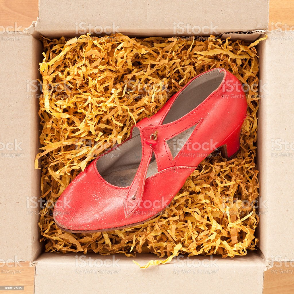 Red old shoe in cardboard box royalty-free stock photo
