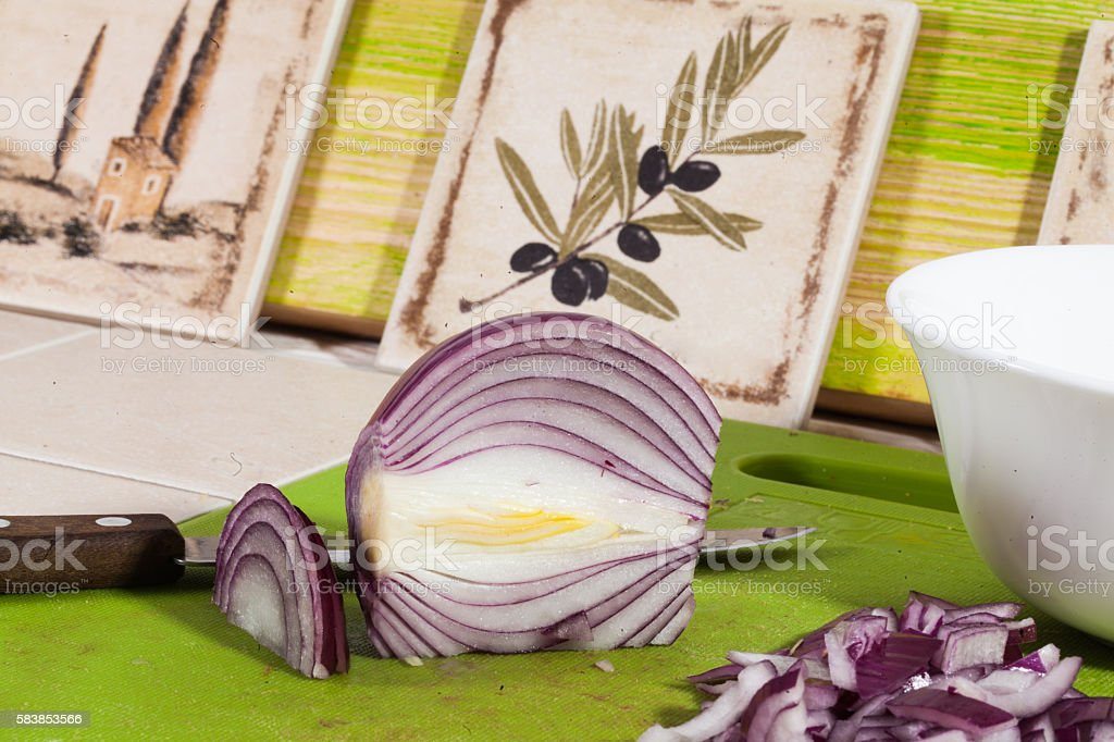red onion sliced on the board, knife, kitchen, cooking stock photo