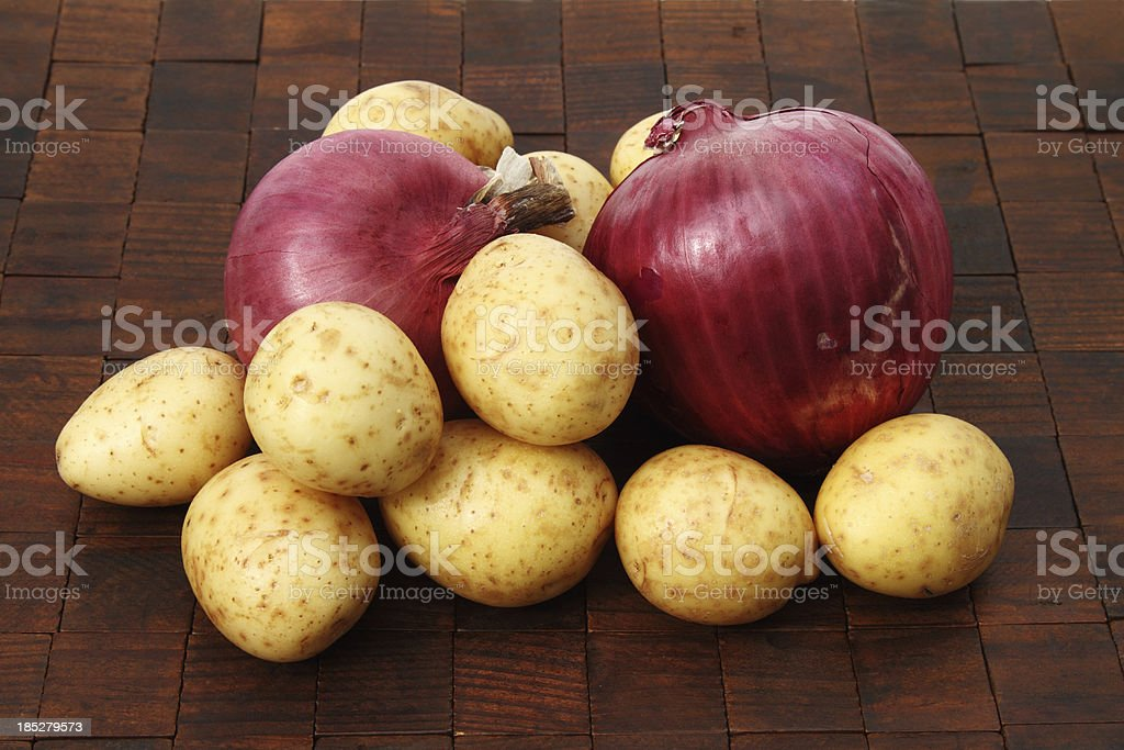 Red onions and small golden potatoes stock photo
