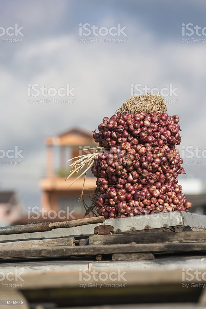 Red onions at the Floating Market in Can Tho royalty-free stock photo