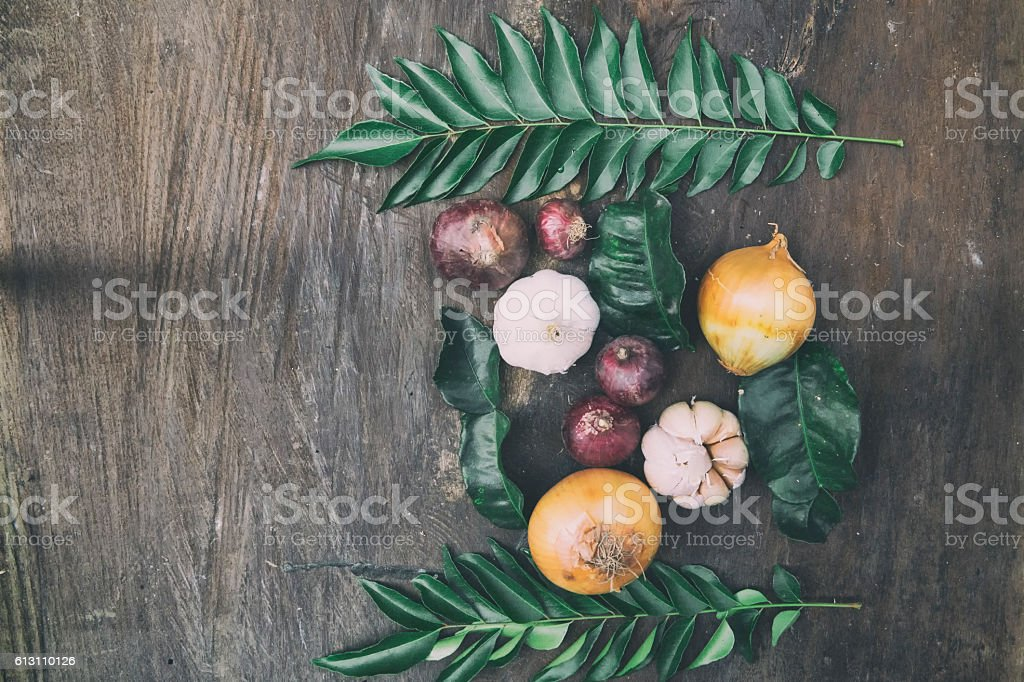 Red onions, garlics, shallots kafir lime leaves and curry leaves stock photo