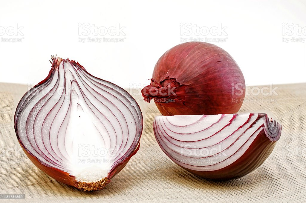 red onions on a beige plate stock photo