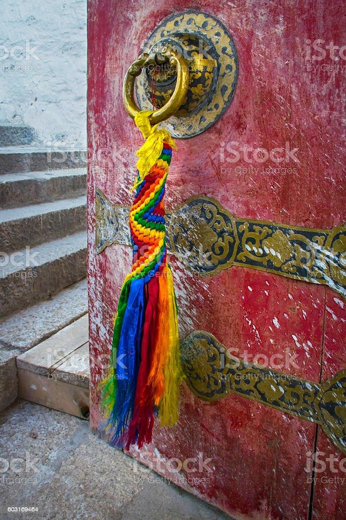 Red open door with prayer flags in a Tibetan monastery stock photo