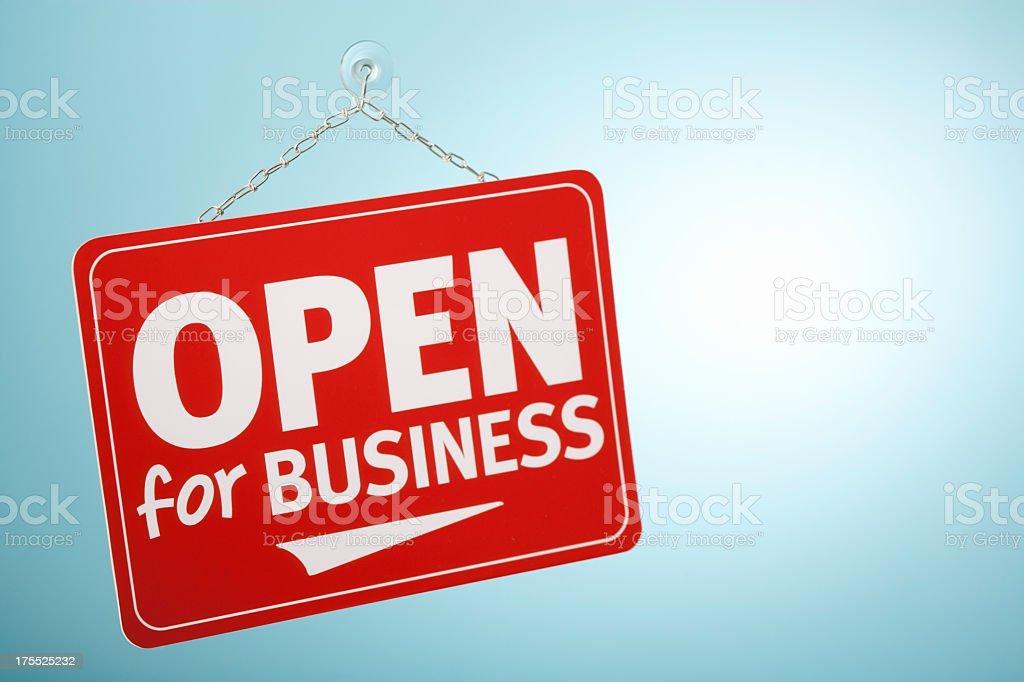 Red open for business sign hanging in a window royalty-free stock photo