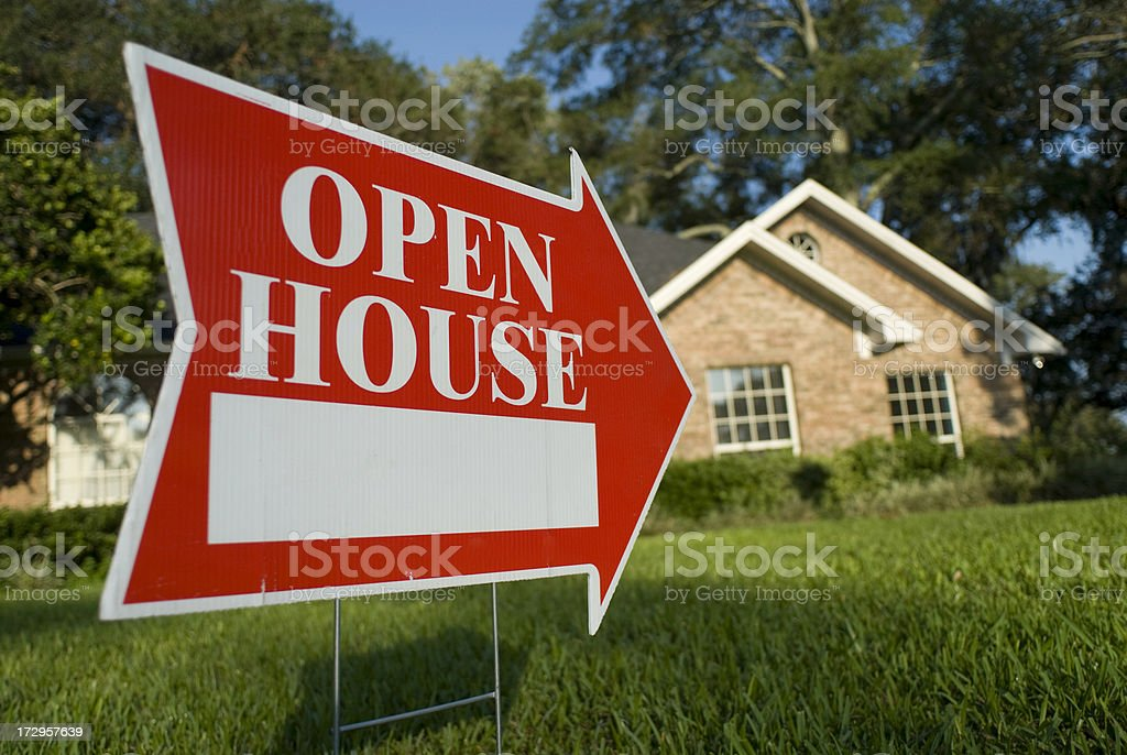 Red Open House sign pointing at house for inspection stock photo