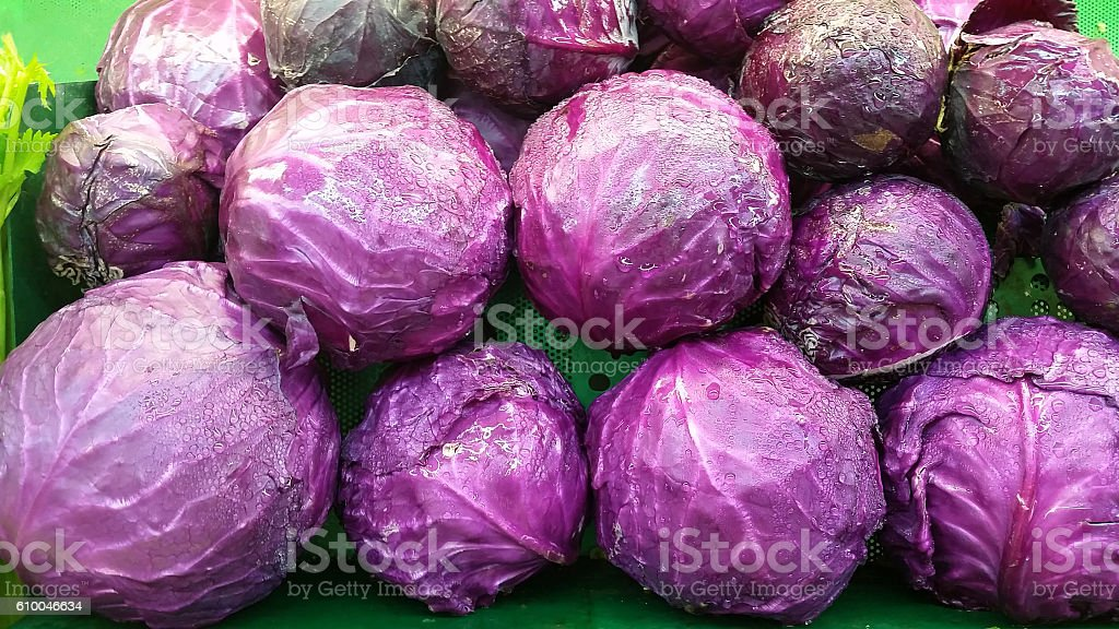 Red or purple cabbage on a produce shelf stock photo
