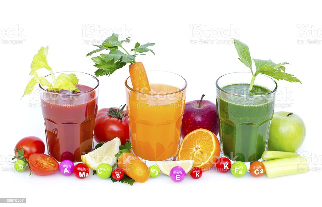 Red orange and green fresh juices surrounded by fruit stock photo